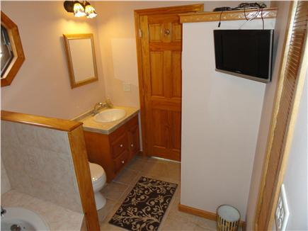 West Yarmouth Cape Cod vacation rental - Bathroom with stackable w/d soaking tub & TV