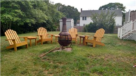 West Yarmouth Cape Cod vacation rental - Fire Pit with comfy Adirondack chairs and side tables