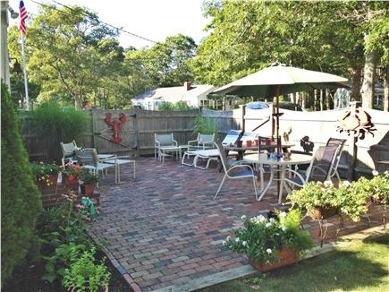 South yarmouth Cape Cod vacation rental - Large brick patio, beautful flowers in season, picnic table