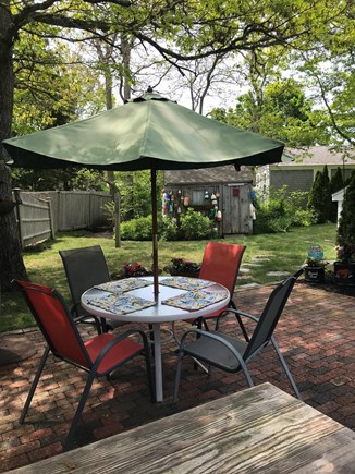 South yarmouth Cape Cod vacation rental - Brick patio, round table with umbrella and a picnic table....