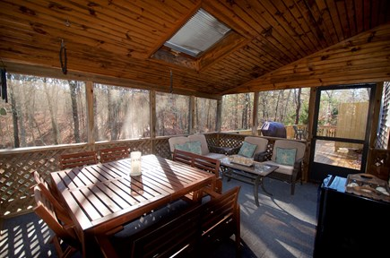South Dennis Cape Cod vacation rental - Relaxing screened in porch and open deck