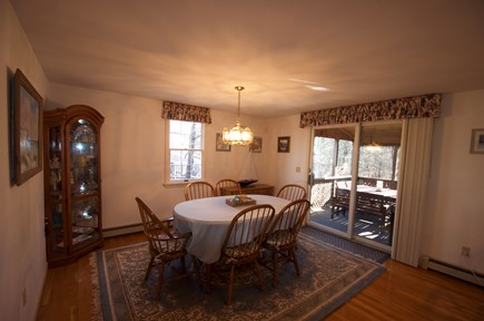 South Dennis Cape Cod vacation rental - Plenty of seating in the dining room and screened porch.