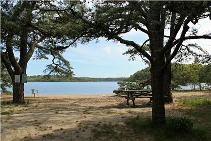 Brewster Cape Cod vacation rental - Beach with picnic tables and Coleman canoe.