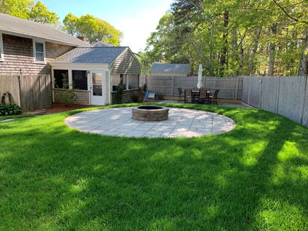 South Yarmouth Cape Cod vacation rental - Patio and fire pit area with privacy fence