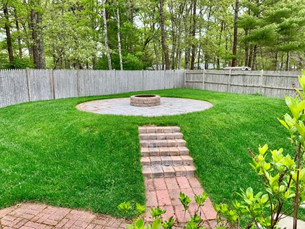 South Yarmouth Cape Cod vacation rental - Fire pit area with privacy fence