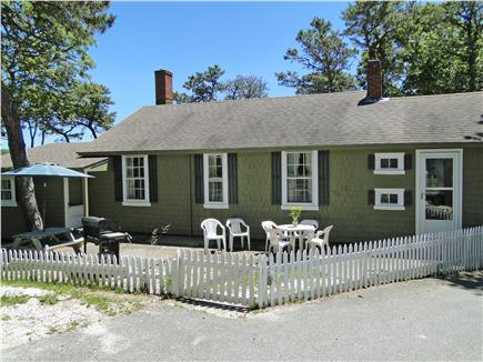 South Chatham Cape Cod vacation rental - Front patio with table and grill, private surroundings