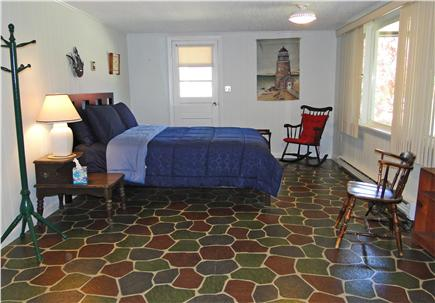 Eastham Cape Cod vacation rental - Lower level bedroom with slider to back patio
