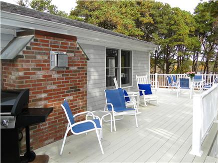 Eastham Cape Cod vacation rental - Wrap around deck with grill, dining and water views