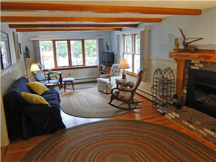 Eastham Cape Cod vacation rental - Large living room with TV, fireplace, water views
