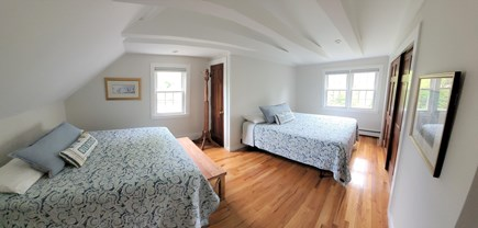 East Falmouth Cape Cod vacation rental - 2nd floor spacious bedroom - two queens and new cathedral ceiling