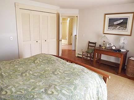 Chatham Cape Cod vacation rental - Upstairs Queen BR - fan, bureau, closet, outdoor deck off BR