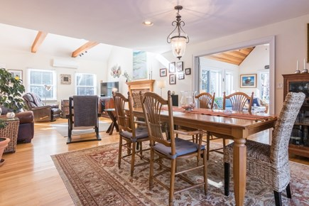 Wellfleet Cape Cod vacation rental - Dining area opens to living, kitchen, sunroom and deck,