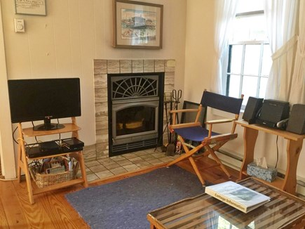 Chatham Cape Cod vacation rental - Fireplace across from sofa, Cable TV, Audio system.