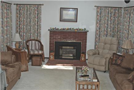 Falmouth Cape Cod vacation rental - Great room, love seat, recliner and sleep sofa and gas fireplace