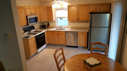 Marshfield, Brant Rock MA vacation rental - Eat-in kitchen with all conveniences + beautiful ocean breezes!
