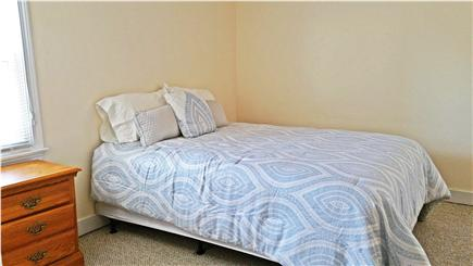 Marshfield, Brant Rock MA vacation rental - Downstairs bedroom with queen bed and a window A/C unit.