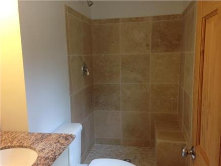 Brewster Cape Cod vacation rental - Master bath w/bench seat -- new floors, sink, toilet, shower