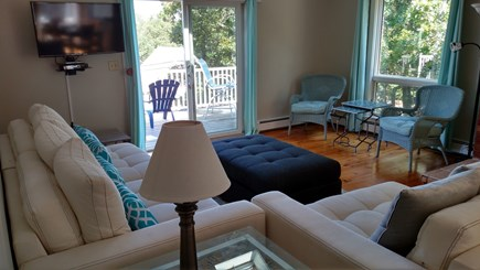Brewster Cape Cod vacation rental - Living room and sliders to deck