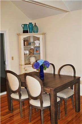 North Falmouth Cape Cod vacation rental - Dining area with two sliding doors to wrap around porch