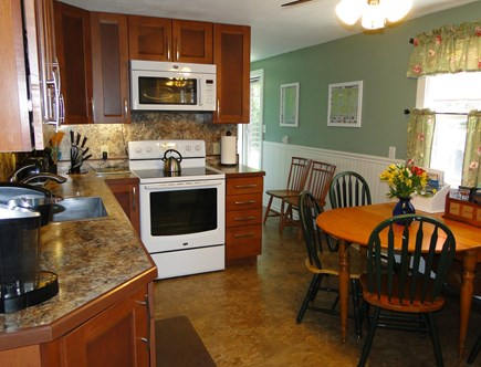 Falmouth, Teaticket Cape Cod vacation rental - Modern kitchen with door to deck