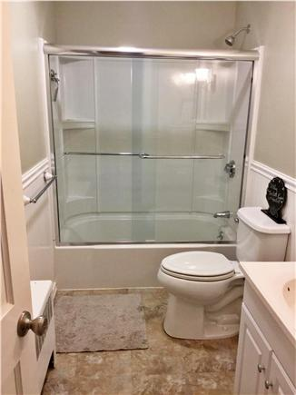 Falmouth, Teaticket Cape Cod vacation rental - Main bath. Glass doors have been added instead of shower curtain.