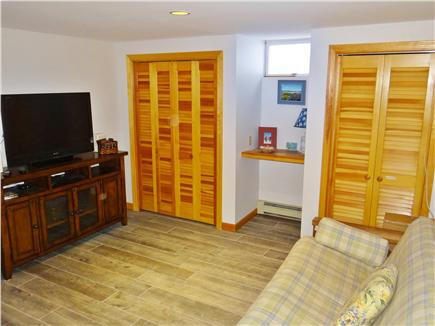 Chatham Cape Cod vacation rental - Downstairs has new flooring, a fireplace, futon and TV.