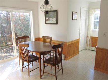East Harwich Cape Cod vacation rental - Kitchen dining area with sliders to deck