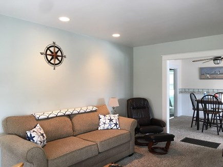 Onset MA vacation rental - Living room with WiFI,40 ''HD TV ,  cozy fireplace & Dining room