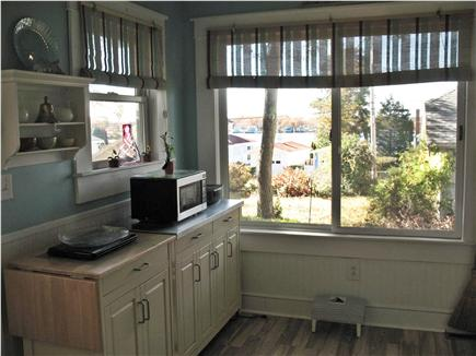 Onset MA vacation rental - Water view from this end of the kitchen , washer & dryer closet