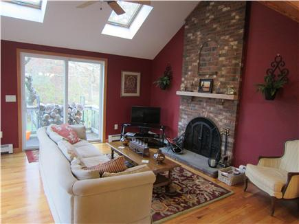 Brewster Cape Cod vacation rental - Living area with fireplace, wet bar, TV, and walkout deck