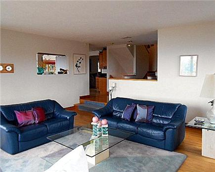 Plymouth MA vacation rental - Bright & sunny living room with floor to ceiling stone fireplace