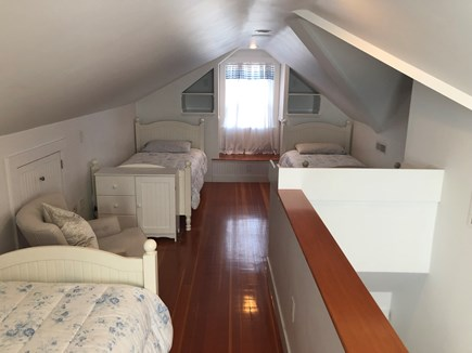 West Yarmouth Cape Cod vacation rental - Attic bedroom #6 has three twin beds and its own deck w/view.