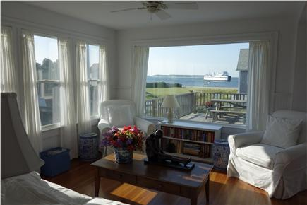 West Yarmouth Cape Cod vacation rental - Sitting area in kitchen, with deck & picnic table right outside.