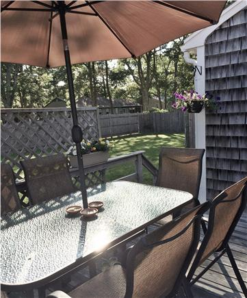 West Yarmouth Cape Cod vacation rental - View from deck to back yard