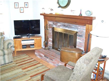 Eastham Cape Cod vacation rental - Living room with TV and fireplace