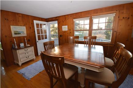 East Orleans Cape Cod vacation rental - Dining area and door to large porch overlooking conservation area