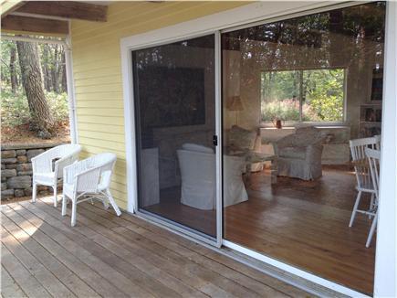 Wellfleet Cape Cod vacation rental - Wrap around deck looking into the living room.
