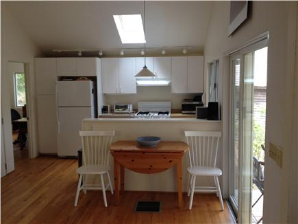 Wellfleet Cape Cod vacation rental - View of kitchen from living room/ dining room.