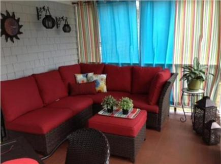 East Falmouth Cape Cod vacation rental - Screened porch with sectional couch