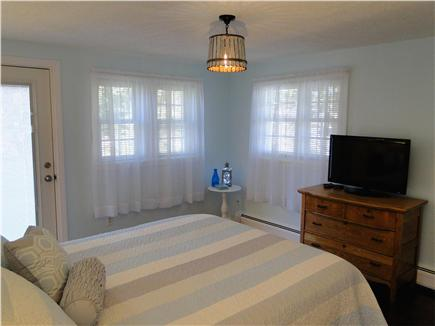 Barnstable Harbor Cape Cod vacation rental - Master bedroom with queen bed, flat screen, door to outside