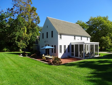 Dennis Cape Cod vacation rental - Large back yard, showing screened porch