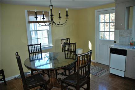 Harwichport Cape Cod vacation rental - Dining area of kitchen and back door