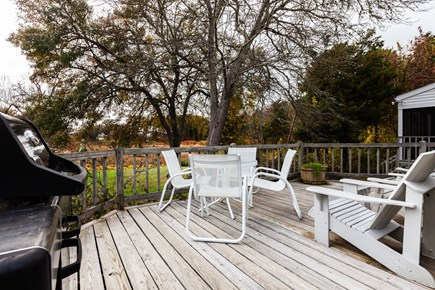 Orleans Cape Cod vacation rental - Main deck with grill and outdoor furniture overlooks the backyard