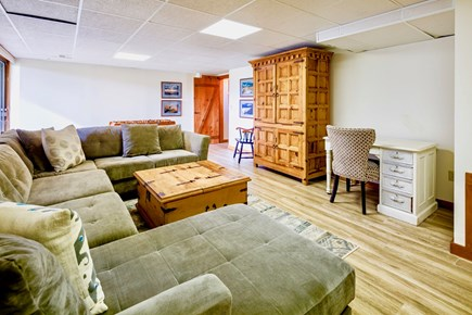 Orleans Cape Cod vacation rental - Lower level family room with TV, large sectional sofa and foosbal