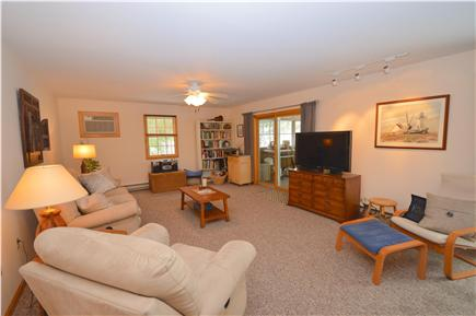 Truro Cape Cod vacation rental - Living room with large A/C unit installed. Slider leads to porch