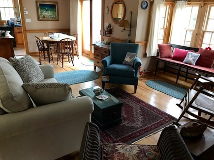 S. Chatham Cape Cod vacation rental - Sitting room dining and slider to deck and grill