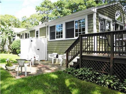 South Dennis Cape Cod vacation rental - Backyard with deck & patio