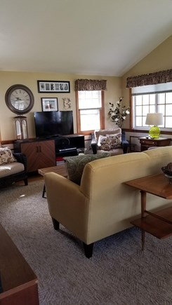 South Dennis Cape Cod vacation rental - Great room with living and dining area, TV and stereo