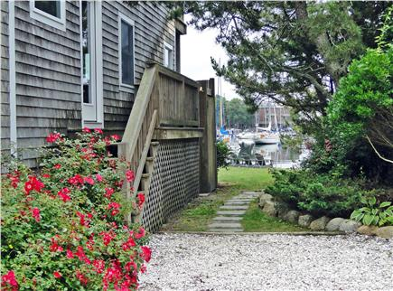 Woods Hole Woods Hole vacation rental - View from driveway to back yard, water
