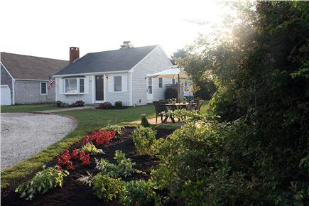West Yarmouth Cape Cod vacation rental - Exterior landcaping, plantings, patio w/set, firepit & gas grill